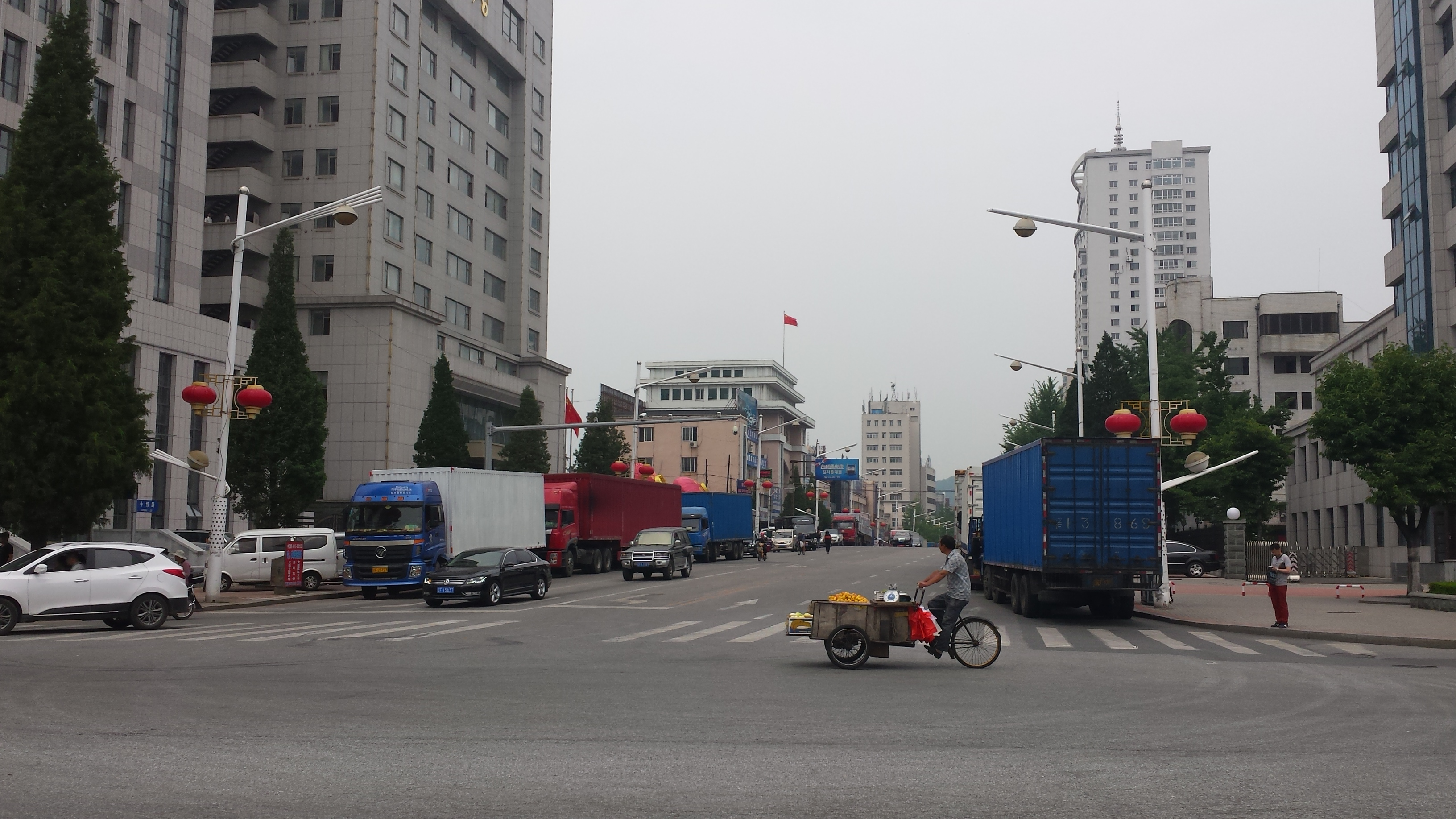 n economy watch acirc foreign direct investment both sides of the street at one of the main intersections in central dandong waiting to go into the customs inspection area to cross into